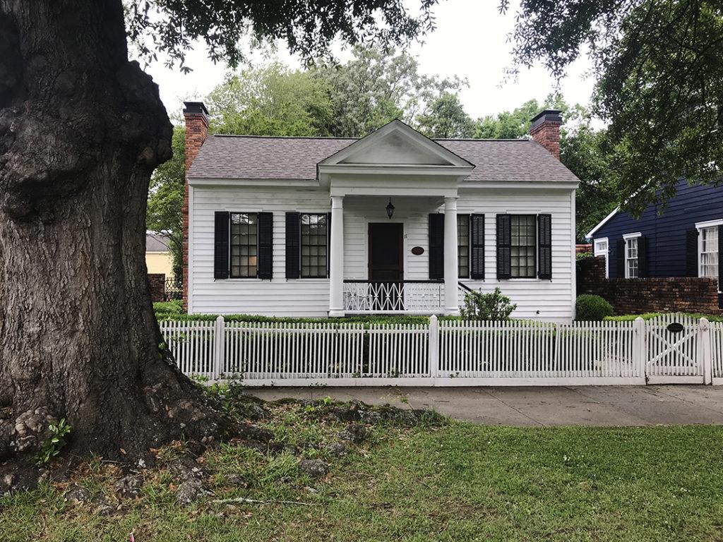 A small white house.