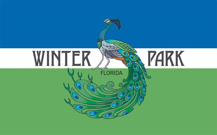 The flag of Winter Park, Florida featuring a peacock.