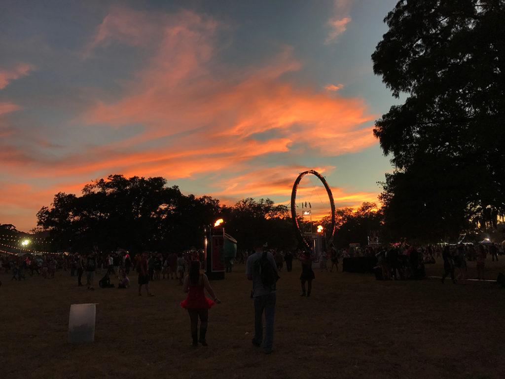 The sun sets on a music festival.