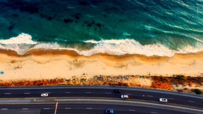 A shot of the highway and ocean near Laguna Beach, California.