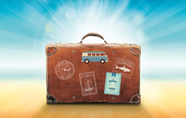 A suitcase illustration featuring travel stamps.